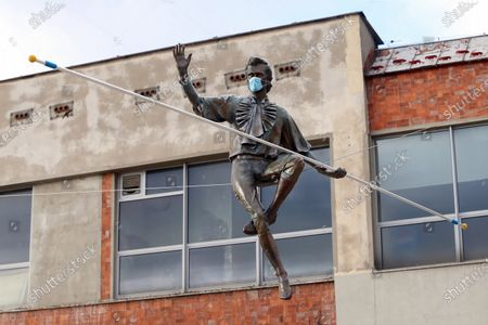 The balancing sculpture of the French high-wire Philippe Petit by Polish artist Jerzy Kedziora is on display at the Old Market Square in Czestochowa, southern Poland, 20 November 2020. Jerzy Kedziora showing his works of art in many galleries all around the world.