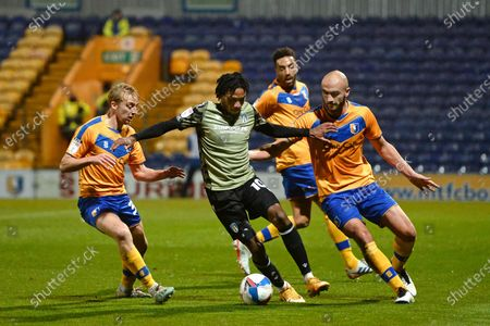Jevani Brown of Colchester United in action with George Lapsie (L) and Farrend Rawson (R) of Mansfield Town - Mansfield Town v Colchester United, Sky Bet League Two, Field Mill, Mansfield, UK - 20th November 2020