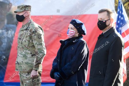 (L-R) Deputy commander of the 5th US Army Corps General Terrence J. McKenrick, US Ambassador to Poland Georgette Mosbacher and Polish Defence Minister Mariusz Blaszczak attend an official inauguration of the forward command of the 5th US Army Corps in Poznan, west-central Poland, 20 November 2020.