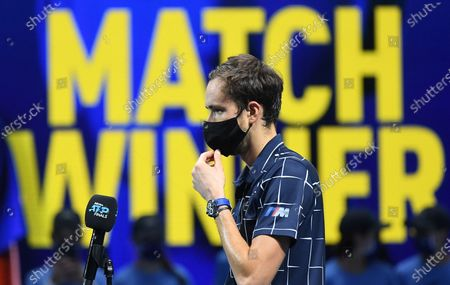 Daniil Medvedev of Russia, wearing a protective face mask, addresses to media after winning against Diego Schwartzman of Argentina during their group stage match at the ATP Finals tennis tournament in London, Britain, 20 November 2020.