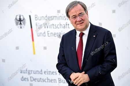 Prime Minister of North Rhine-Westphalia Armin Laschet speaks to the media as he visits the production facility of Innovatec Microfibre Technology, amid the on-going Covid-19 pandemic, in Troisdorf, Germany, 20 November 2020. The occasion was the commissioning of the first of three new lines for the production of meltblown nonwovens. Meltblown is the heart of every medical protective mask and is urgently needed in the current corona crisis worldwide for the production of surgical and FFP masks. Countries around the world are taking increased measures to stem the widespread of the SARS-CoV-2 coronavirus which causes the COVID-19 disease.