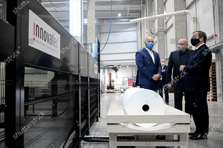Prime Minister of North Rhine-Westphalia Armin Laschet (R) talks to managing director Daniel Jaeger (2-R) as he visits the production facility of Innovatec Microfibre Technology, amid the on-going Covid-19 pandemic, in Troisdorf, Germany, 20 November 2020. The occasion was the commissioning of the first of three new lines for the production of meltblown nonwovens. Meltblown is the heart of every medical protective mask and is urgently needed in the current corona crisis worldwide for the production of surgical and FFP masks. Countries around the world are taking increased measures to stem the widespread of the SARS-CoV-2 coronavirus which causes the COVID-19 disease.
