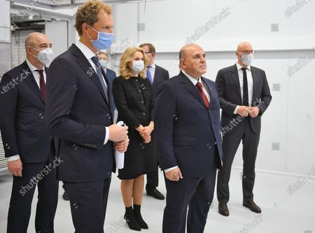 Stock Picture of Visit of Russian Prime Minister Mikhail Mishustin to Dubna. Russian Prime Minister Mikhail Mishustin (second right), Head of the Federal Tax Service of Russia Daniil Yegorov (second left), Russian Finance Minister Anton Siluanov (left) and Deputy Prime Minister Tatyana Golikova (center) during a visit to the new Federal Center data processing by the Federal Tax Service of Russia.