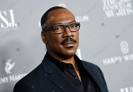"""Honoree actor-comedian Eddie Murphy attends the WSJ. Magazine 2019 Innovator Awards in New York on . """"Coming 2 America,"""" the sequel to the 1988 Eddie Murphy comedy, has landed on a date to come to audiences. Amazon Studios announced Friday that the film which reunites Murphy and Arsenio Hall will debut on Amazon Prime Video on March 5, 2021"""