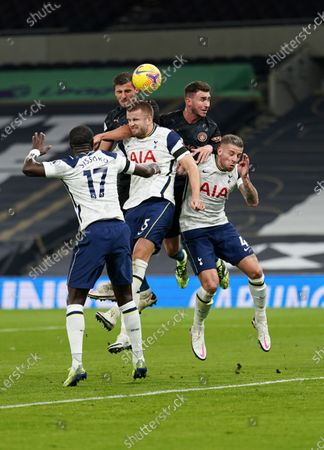 Rodri and Aymeric Laporte of Manchester City get higher than Moussa Sissoko, Eric Dier and Toby Alderweireld of Tottenham Hotspur to head the ball