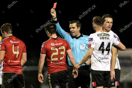 Stock Image of Bohemians vs Dundalk. Bohemians' Michael Barker receives a red card from referee Robert Harvey