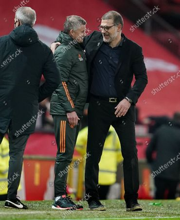 Stock Image of Manchester United manager Ole Gunnar Solskjaer with counterpart Slaven Bilic of West Bromwich Albion at the end of the game