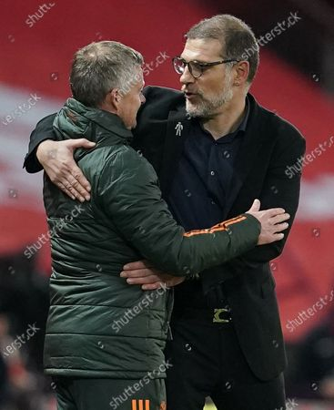 Manchester United manager Ole Gunnar Solskjaer with counterpart Slaven Bilic of West Bromwich Albion at the end of the game