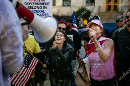 Trump supporters argue with a group of Biden supporters outside the Georgia Capitol Building on Wednesday, Nov. 18, 2020 in Atlanta, GA. (Jason Armond / Los Angeles Times)