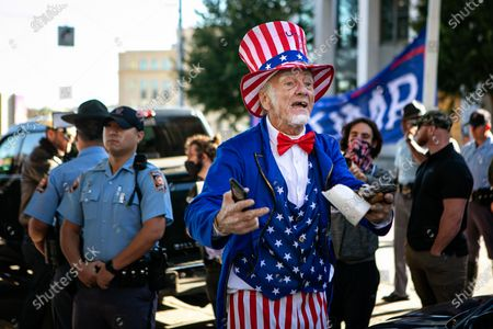 A man dressed as Uncle Sam along with a few hundred Trump supporters attend the Stop the Steal rally at the Georgia Capitol Building on Wednesday, Nov. 18, 2020 in Atlanta, GA. (Jason Armond / Los Angeles Times)