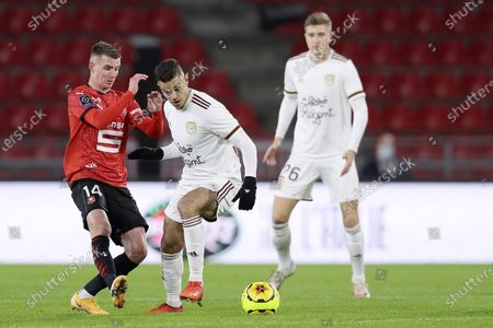 Rennes' Benjamin Bourigeaud, left, fights for the ball with Bordeuax's Hatem Ben Arfa during the League One soccer match between Rennes and Bordeaux, at the Roazhon Park stadium in Rennes, France