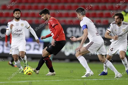 Rennes' Martin Terrier controls the ball Bordeaux's Laurent Koscielny, second right, during the League One soccer match between Rennes and Bordeaux, at the Roazhon Park stadium in Rennes, France