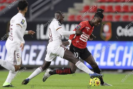 Reims' Arber Zeneli, right, challenges for the ball with Bordeaux's Youssouf Sabaly during the League One soccer match between Rennes and Bordeaux, at the Roazhon Park stadium in Rennes, France
