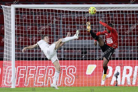 Rennes' Brandon Soppy, right, fights for the ball with Bordeaux's Laurent Koscielny, left, during the League One soccer match between Rennes and Bordeaux, at the Roazhon Park stadium in Rennes, France