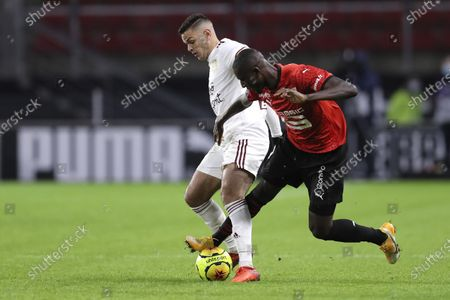 Rennes' Serhou Guirassy, right, fights for the ball with Bordeuax's Hatem Ben Arfa left, during the League One soccer match between Rennes and Bordeaux, at the Roazhon Park stadium in Rennes, France