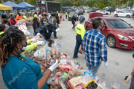 Editorial picture of Volunteers deliver Thanksgiving meal distribution  in front of Miami City Hall, USA - 20 Nov 2020