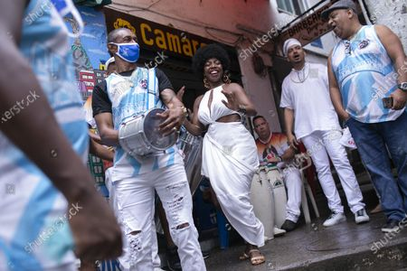 Members of the Mocidade Unida do Santa Marta samba school dance for a ceremony marking Black Consciousness Day in the Santa Marta favela of Rio de Janeiro, Brazil, . Brazilians celebrate the holiday with Afro-Brazilian dance, music and religious ceremonies, reflecting the deep cultural and social ties of the Black community to the country's history and honor legendary anti-slave leader Zumbi dos Palmares on the day of his death