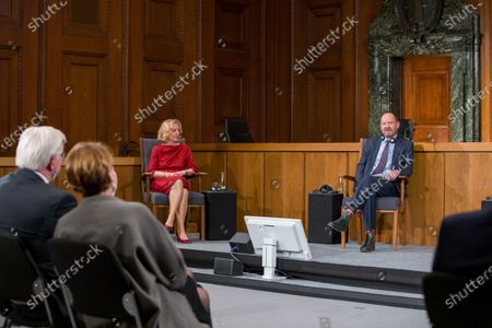 Stock Image of Former Vice President of the European Court of Human Rights Angelika Nussberger (L) speaks at a panel discussion alongside Philippe Sands (R), author, lawyer and international law expert, during a ceremony marking the 75th anniversary of the Nuremberg trials at the Room 600 in the Nuremberg Palace of Justice in Nuremberg, Germany, 20 November 2020. On 20 November 1945 started The major World War II criminals trial, accused of war crimes, against peace and against humanity,  before the International Military Tribunal (IMT).