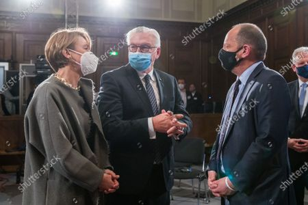 German President Frank-Walter Steinmeier (C) and his wife Elke Buedenbender (L) talk to Philippe Sands (R), author, lawyer and international law expert, during a ceremony marking the 75th anniversary of the Nuremberg trials at the Room 600 in the Nuremberg Palace of Justice in Nuremberg, Germany, 20 November 2020. On 20 November 1945 started The major World War II criminals trial, accused of war crimes, against peace and against humanity,  before the International Military Tribunal (IMT).
