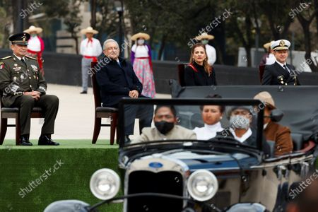 Mexican President Andres Manuel Lopez Obrador (2-L), Mexican First Lady Beatriz Gutierrez (2-R) and Mexican Secretary of National Defence Luis Cresencio Sandoval (2-L) and Secretary of Mexican Navy Rafael Ojeda (R) attend a celebration as part of the 110th anniversary of Mexican revolution, in Mexico City, Mexico, 20 November 2020.