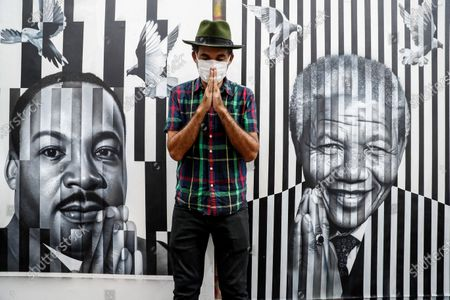 Stock Picture of Brazilian street artist Eduardo Kobra poses in front of one of his artworks, which depicts Martin Luther King Jr. (L) and Nelson Mandela, after an interview with Spanish international news agency Efe at his workshop in Sao Paulo, Brazil, 19 November 2020 (issued 20 November 2020). During the interview, Kobra, 45, said, 'I realized that if I stop painting, my death is imminent.' The artist spoke about his relationship with art and his new, most 'autobiographical' work, which he created when morning the loss of his newborn child just hours after birth as the coronavirus Covid-19 pandemic emergency began.