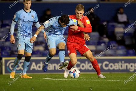 Stock Photo of Coventry City's Gustavo Hamer BIRMINGHAM CITY'S Riley McGree during the EFL Sky Bet Championship match between Coventry City and Birmingham City at the Trillion Trophy Stadium, Birmingham