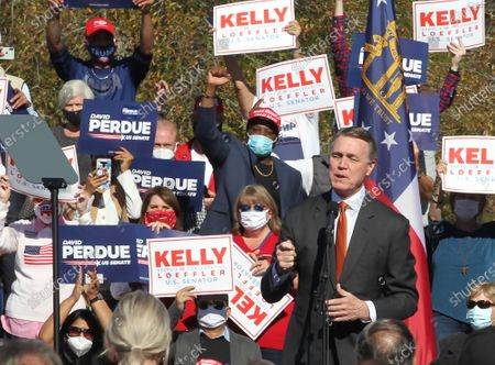 Georgia Republican US Senators David Perdue speaks at a Senate runoff election campaign rally with and Kelly Loeffler (not pictured) and US Vice President Mike Pence (not pictured) at the Cherokee Conference Center at the Bluffs in Canton, Georgia, USA, 20 November 2020. Perdue faces Democrat Jon Ossoff and Loeffler faces Democrat Rafael Warnock in a 05 January 2021 runoff election.