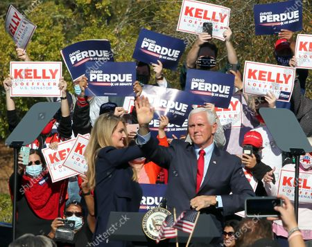 Georgia Republican US Senator Kelly Loeffler waves to the crowd along with US Vice President Mike Pence as he participates in a Senate runoff election campaign rally at the Cherokee Conference Center at the Bluffs in Canton, Georgia, USA, 20 November 2020. Perdue faces Democrat Jon Ossoff and Loeffler faces Democrat Rafael Warnock in a 05 January 2021 runoff election.