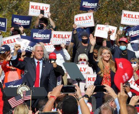 Georgia Republican US Senator Kelly Loeffler (R) waves to the crowd along with US Vice President Mike Pence (L) as he participates in a Senate runoff election campaign rally at the Cherokee Conference Center at the Bluffs in Canton, Georgia, USA, 20 November 2020. Perdue faces Democrat Jon Ossoff and Loeffler faces Democrat Rafael Warnock in a 05 January 2021 runoff election.