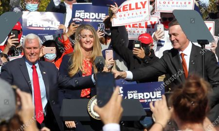 US Vice President Mike Pence (L) participates in a Senate runoff election campaign rally with Georgia Republican US Senators David Perdue (R) and Kelly Loeffler at the Cherokee Conference Center at the Bluffs in Canton, Georgia, USA, 20 November 2020. Perdue faces Democrat Jon Ossoff and Loeffler faces Democrat Rafael Warnock in a 05 January 2021 runoff election.