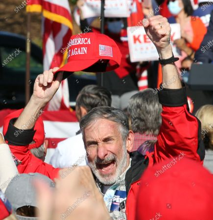 Stock Image of A man shouts during a Senate runoff election campaign rally for Georgia Republican US Senators David Perdue and Kelly Loeffler at the Cherokee Conference Center at the Bluffs in Canton, Georgia, USA, 20 November 2020. Perdue faces Democrat Jon Ossoff and Loeffler faces Democrat Rafael Warnock in a 05 January 2021 runoff election.