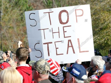 A 'Stop The Steal' sign at a Senate runoff election campaign rally for Georgia Republican US Senators David Perdue and Kelly Loeffler at the Cherokee Conference Center at the Bluffs in Canton, Georgia, USA, 20 November 2020. Perdue faces Democrat Jon Ossoff and Loeffler faces Democrat Rafael Warnock in a 05 January 2021 runoff election.