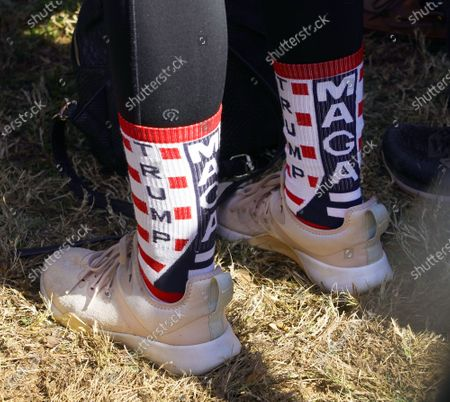 Stock Picture of An attendee wears MAGA and Trump socks as she attends a Senate runoff election campaign rally with US Vice President Mike Pence and US Senators David Perdue and Kelly Loefller at the Cherokee Conference Center at the Bluffs in Canton, Georgia, USA, 20 November 2020. Perdue faces Democrat Jon Ossoff and Loeffler faces Democrat Rafael Warnock in a 05 January 2021 runoff election.