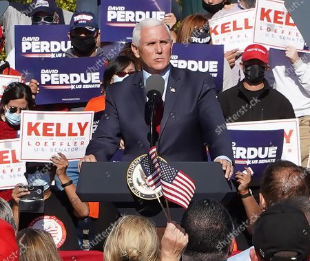 Editorial picture of Vice President Mike Pence at campaign rally with Georgia Republican US Senators David Perdue and Kelly Loeffler, Canton, USA - 21 Nov 2020