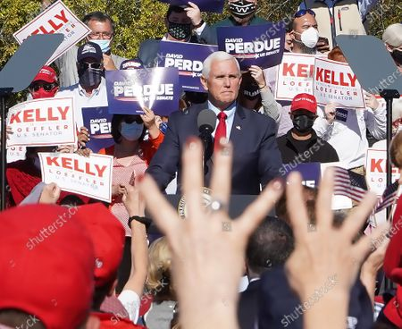 Editorial photo of Vice President Mike Pence at campaign rally with Georgia Republican US Senators David Perdue and Kelly Loeffler, Canton, USA - 21 Nov 2020
