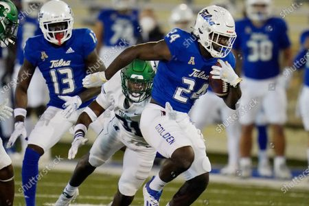 Tulsa running back Corey Taylor II (24) is pursued by Tulane safety Larry Brooks (31) during an NCAA college football game against Tulane in Tulsa, Okla