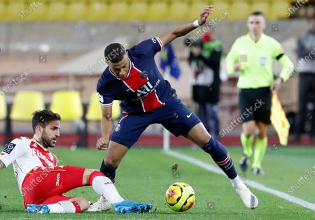 Cesc Fabregas (L) of AS Monaco and Kylian Mbappe (R) of Paris Saint Germain in action during the French Ligue 1 soccer match, AS Monaco vs Paris Saint Germain, at Stade Louis II, in Monaco, 20 November 2020.
