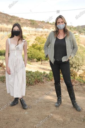 """Mackenzie Foy, left, and Ashley Avis attend an event to promote the film """"Black Beauty"""" at Fair Hill Farms, in Topanga, Calif"""
