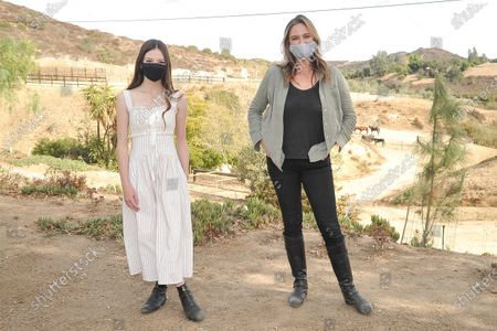 "Stock Picture of Mackenzie Foy, left, and Ashley Avis attend an event to promote the film ""Black Beauty"" at Fair Hill Farms, in Topanga, Calif"
