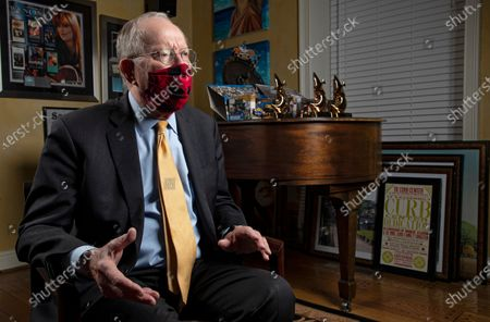 Sen. Lamar Alexander, R-Tenn., speaks from behind a face mask during an interview, in Nashville, Tenn