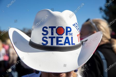 "A supporter of President Trump wears a ""stop the steal"" cowboy hat before Vice President Mike Pence speaks at a campaign rally with Senators Kelly Loeffler and David Perdue before leaving."