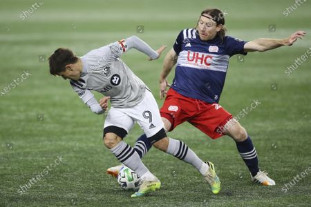New England Revolution midfielder Thomas McNamara, right, defends against Montreal Impact forward Bojan Krkic (9) during the first half of an MLS soccer match, in Foxborough, Mass