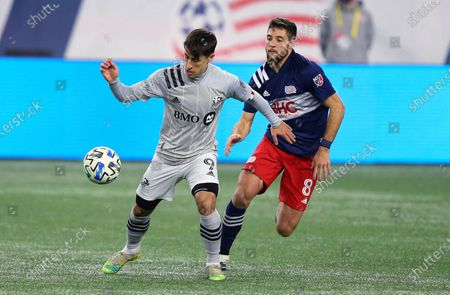 Stock Image of New England Revolution's Matt Polster (8) defends against Montreal Impact's Bojan Krkic (9) during the second half of an MLS soccer match, in Foxborough, Mass. The Revolution won 2-1