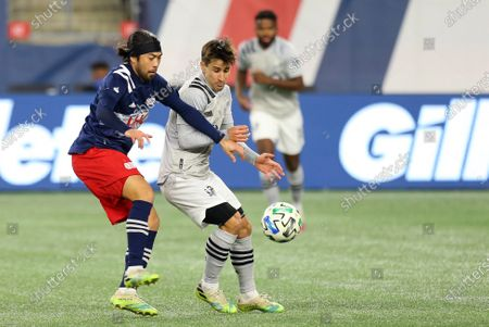 Foxborough, MA, USA; New England Revolution midfielder Lee Nguyen (42) and Montreal Impact forward Bojan Krkic (9) in action during the Eastern Conference Play-in round between Montreal Impact and New England Revolution at Gillette Stadium