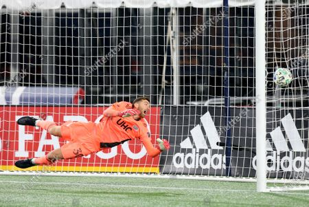 Foxborough, MA, USA; New England Revolution goalkeeper Matt Turner (30) unable to make the save glances at the ball in the goal during the Eastern Conference Play-in round between Montreal Impact and New England Revolution at Gillette Stadium