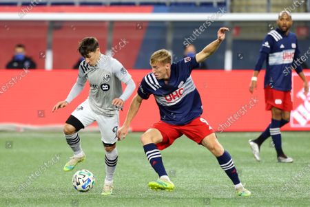 Stock Photo of Foxborough, MA, USA; Montreal Impact forward Bojan Krkic (9) and New England Revolution forward Adam Buksa (9) in action during the Eastern Conference Play-in round between Montreal Impact and New England Revolution at Gillette Stadium