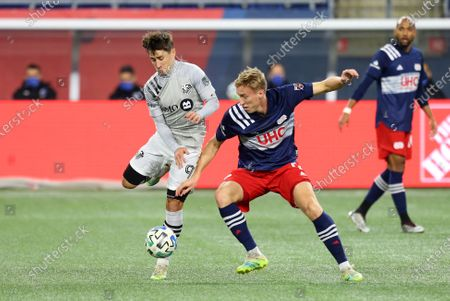 Foxborough, MA, USA; Montreal Impact forward Bojan Krkic (9) and New England Revolution forward Adam Buksa (9) in action during the Eastern Conference Play-in round between Montreal Impact and New England Revolution at Gillette Stadium