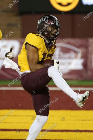 Stock Image of Minnesota wide receiver Seth Green (17) reacts after scoring a touchdown against Purdue during the first half of an NCAA college football game, in Minneapolis. Minnesota won 34-31