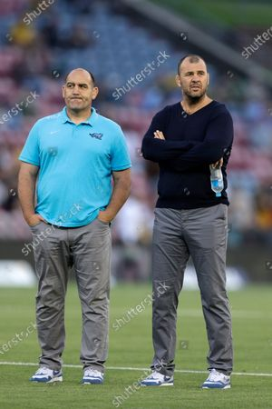 Argentina's coach Mario Ledesma, left, and assistant coach Michael Cheika watch their team before Tri-Nations rugby union match against Australia in Newcastle