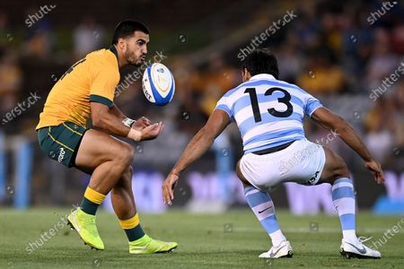 Stock Photo of Tom Wright of the Wallabies is tackled by Matias Orlando of the Pumas during the Tri Nations rugby match between the Argentina Pumas and Australian Wallabies at McDonald Jones Stadium in Newcastle, 21 November 2020.